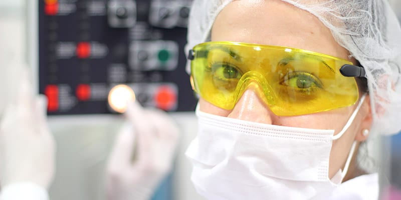 A Female Technician is Monitoring the Process of Pill Packaging